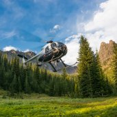 Hughes 500 from Bighorn Helicopters, heading out on bear capture